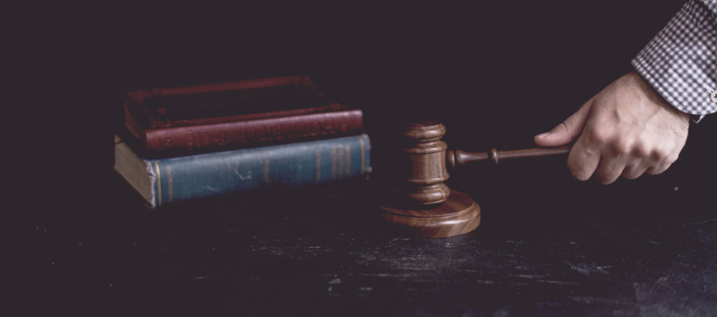 Bankruptcy Attorney Visalia - Labiak Law Group - hand holding gavel with law books